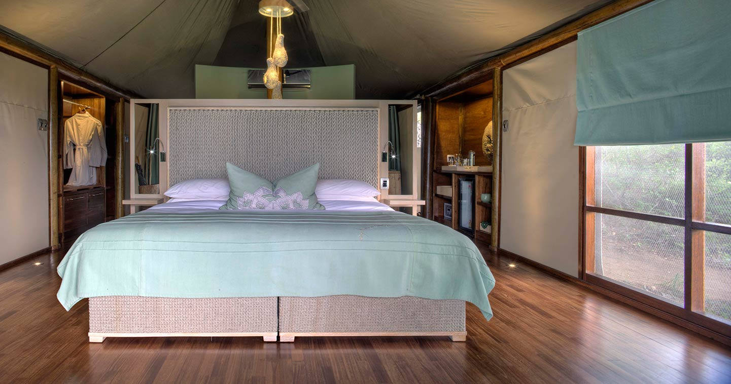 Enjoy the luxury bedroom at Ngala Tented Camp in Timbavati Game Reserve